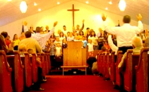 Raised hands of church